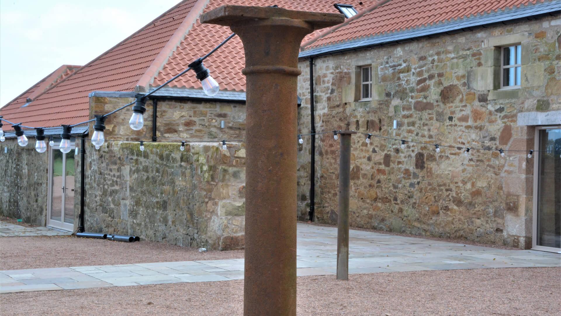 Falside Mill Venue pillar in courtyard