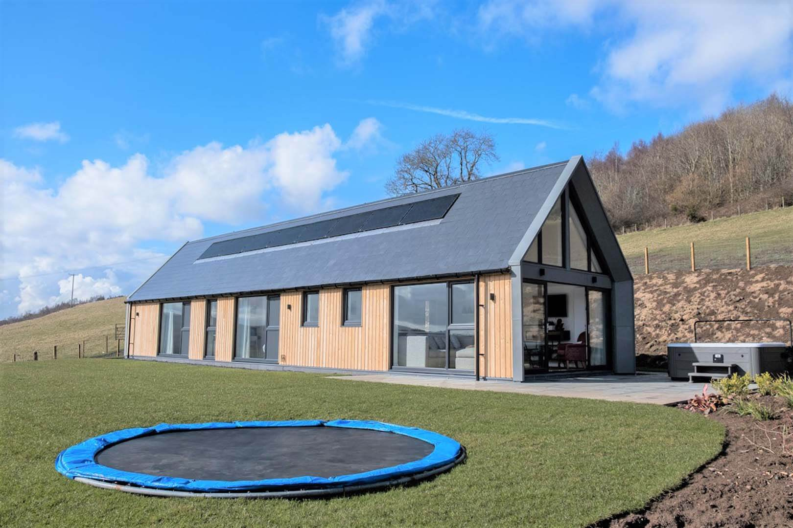 Modern Longhouse front of the house with trampoline