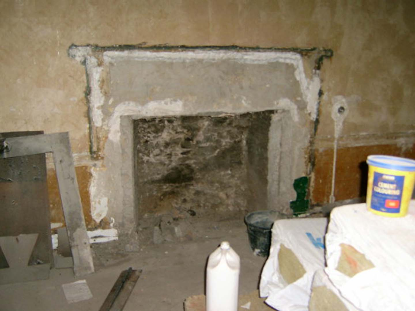 Georgian House image of fireplace being worked on during restoration