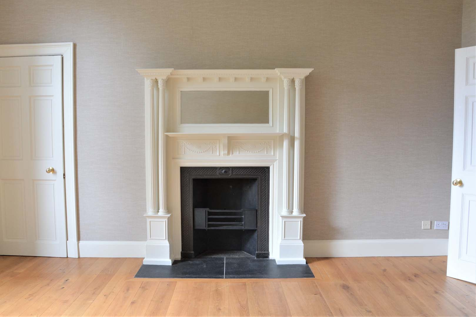 Georgian House image of fireplace in sitting room after restoration