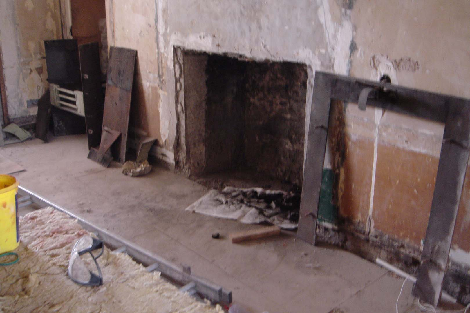 Georgian House image of fireplace and floor before restoration