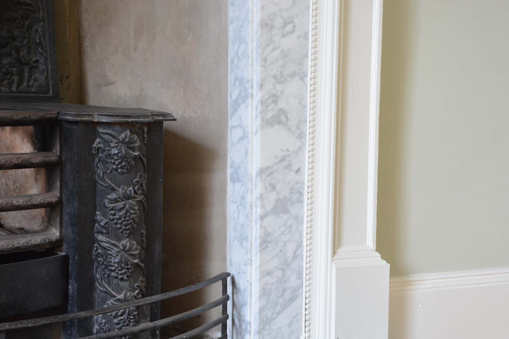 Georgian House image of bottom corner of marble fireplace following restoration