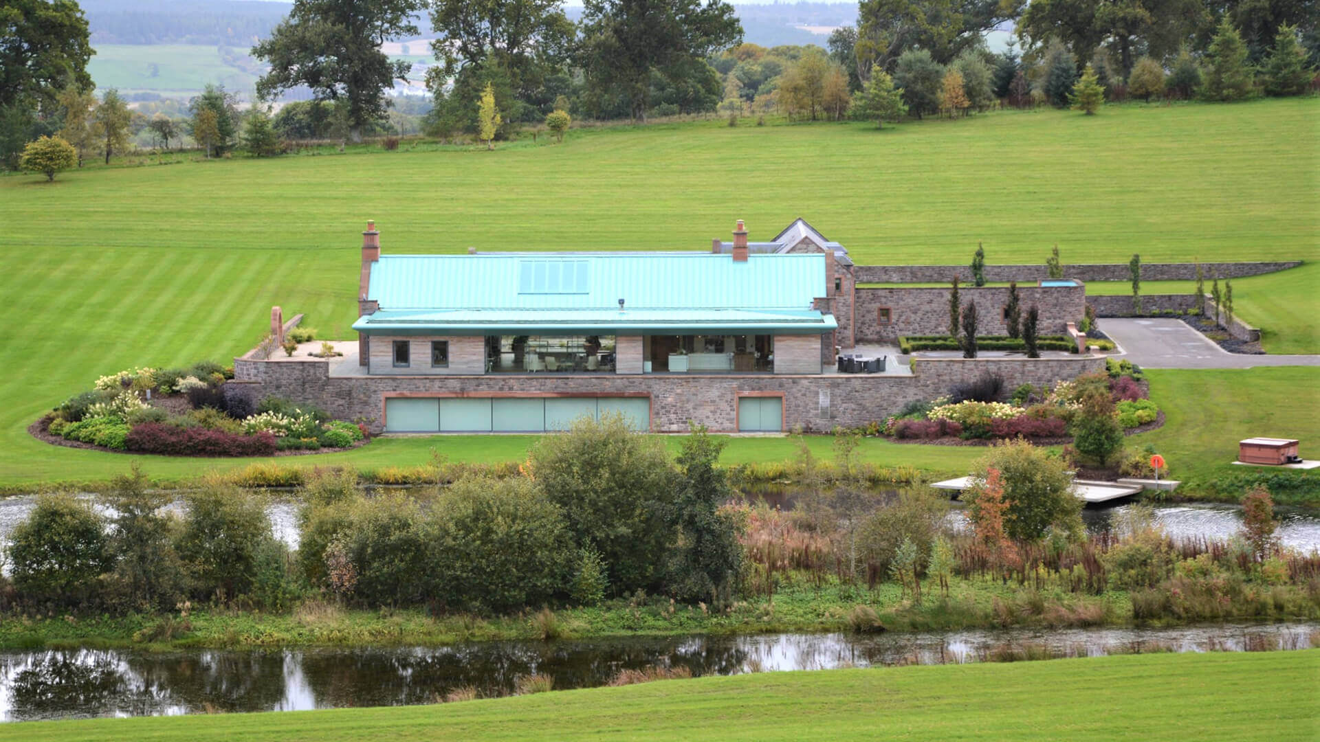 New Country House and Estate view from across river